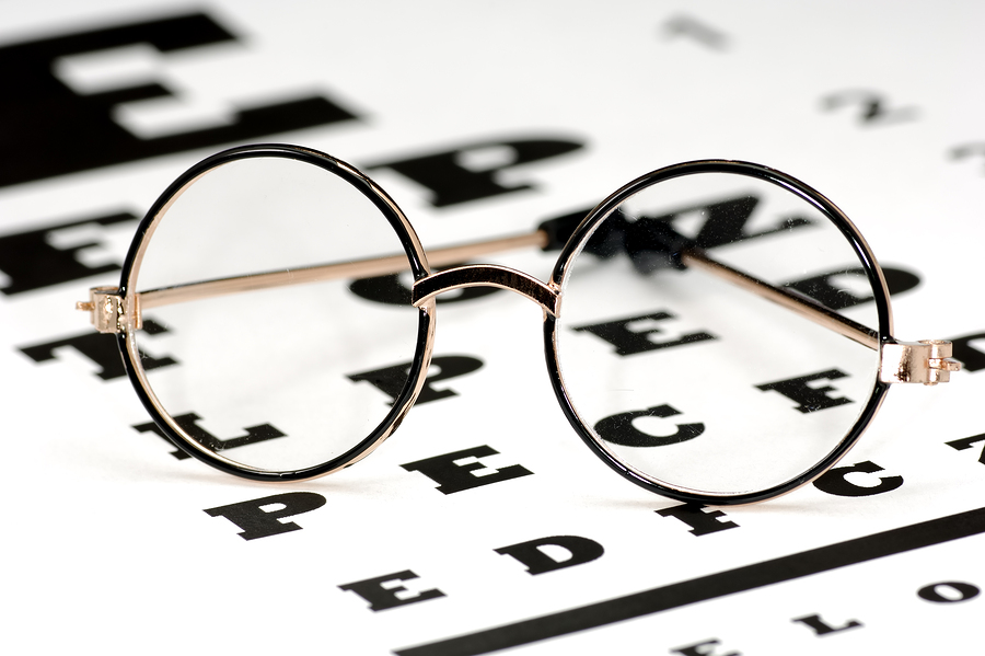 pair of glasses on top of an eye exam chart in Clarksville